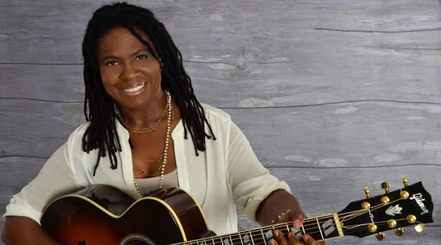 Ruthie Foster holding a guitar